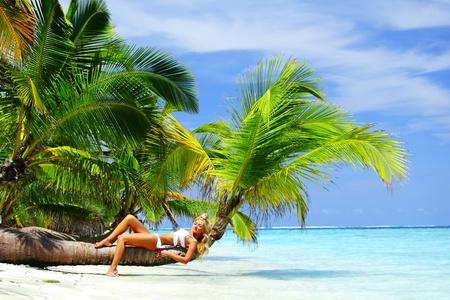 woman on palm sea on backgroud Stock Photo - 12079728