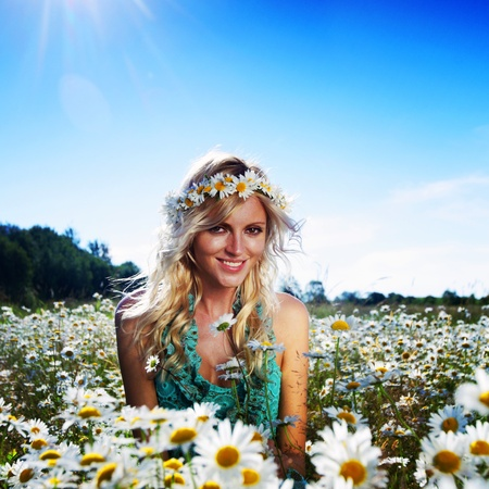 beautiful girl  in dress on the sunny daisy flowers field  photo
