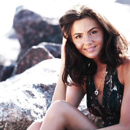 hot legs:  woman portrait on the sea stone