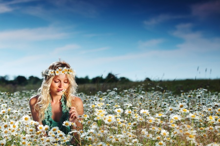 beautiful girl on the daisy flowers field Stock Photo - 12451741