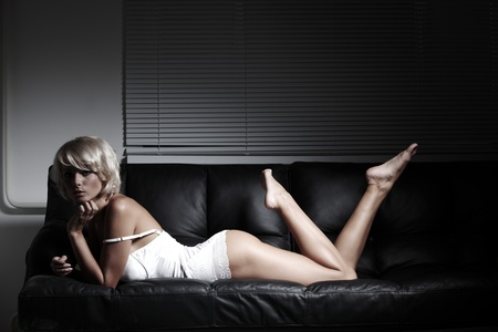 sexy woman on leather sofa Stock Photo - 12508448