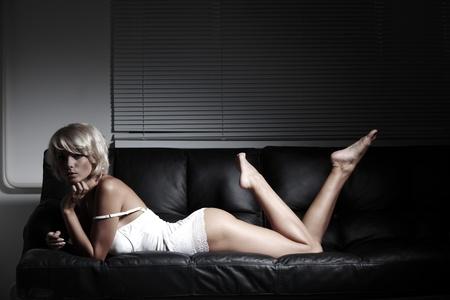 sexy woman on leather sofa Stock Photo - 12508448