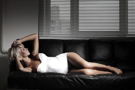sexy woman on leather sofa Stock Photo - 12508551