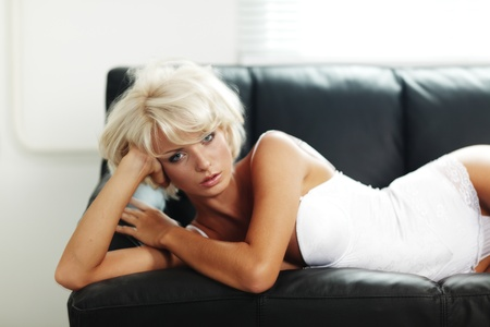 sexy woman on leather sofa Stock Photo - 12507013