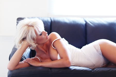 sexy woman on leather sofa Stock Photo - 12508587