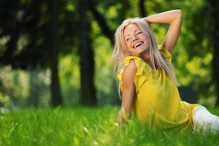 happy woman sitting on grass photo