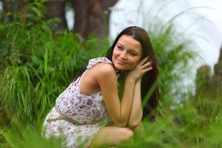 woman on grass in green fields photo