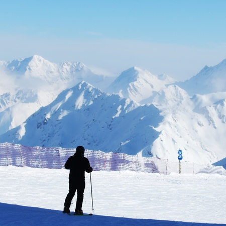 skiers on the mountain backdrop Stock Photo - 12983984