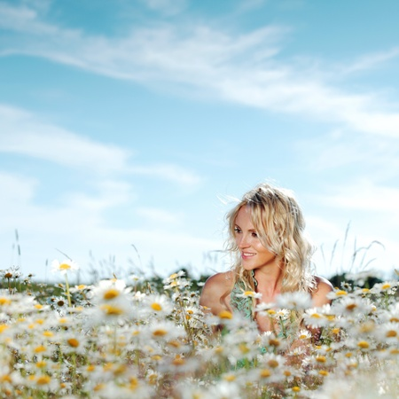 beautiful girl on the daisy flowers field  photo