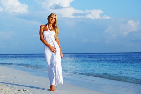 woman in a white dress on the ocean coast Stock Photo - 13121335
