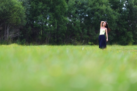 woman on green grass field Stock Photo - 13121469
