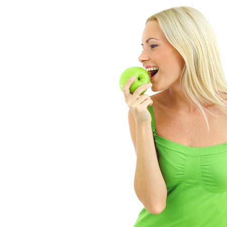 green apple: woman eat green apple on white Stock Photo