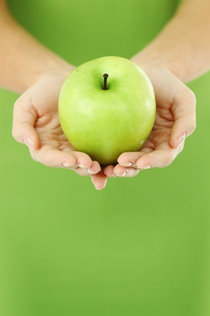 green apple in woman hands