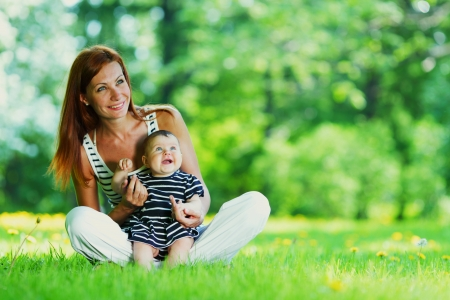 person outside: Happy mother and daughter on grass