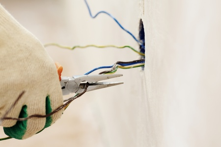 electrical power: worker puts the wires