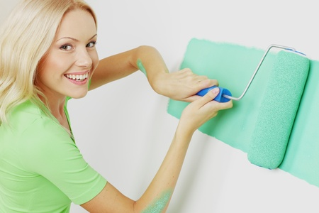 woman paint on the wall Stock Photo - 13587726