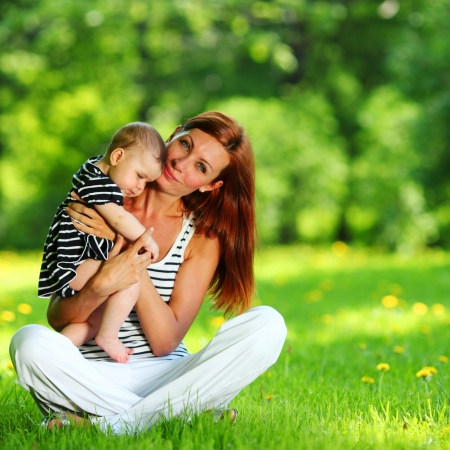Happy mother and daughter on the green grass Stock Photo - 13629244