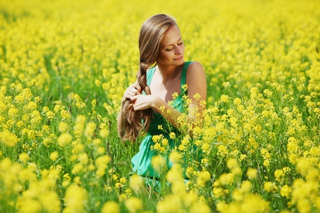 woman on oilseed field photo