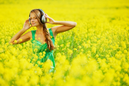 listening to music on oilseed field photo