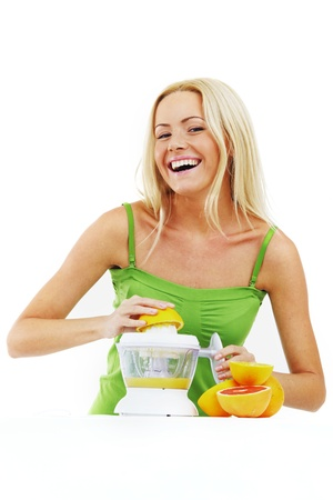 fitness woman make an orange juice Stock Photo - 13687674
