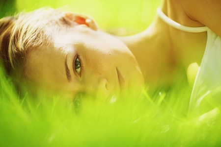 woman sleep on grass photo