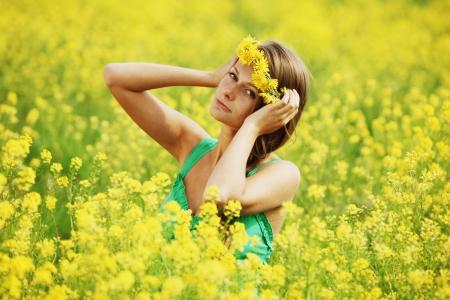 woman on oilseed field photo