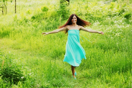 Beautiful Healthy Woman over Nature background photo
