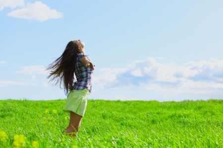 woman on summer green field feel freedom photo