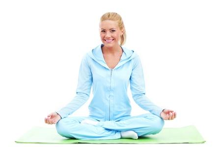 alternative health care: yoga woman studio shot