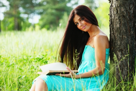 Beautiful Healthy Woman over Nature background Stock Photo
