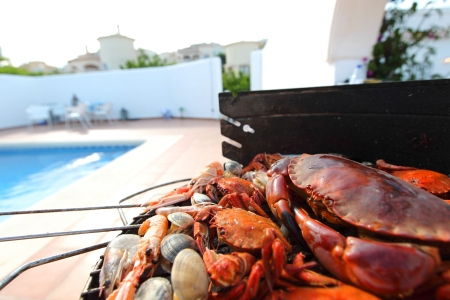 crabs shrimps on charcoal grill photo