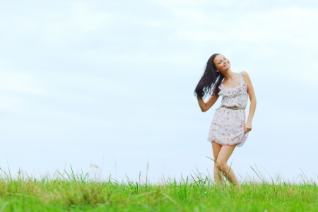 woman on green grass field photo