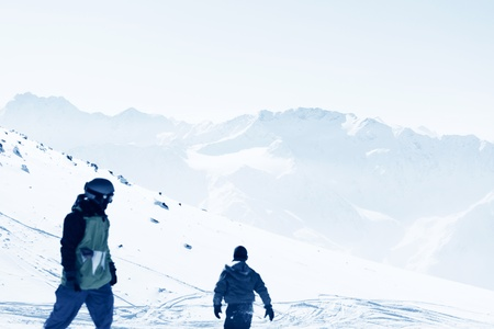 snowboarders on the mountain backdrop photo