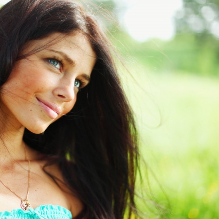 teen girl brown hair: Beautiful Healthy Woman over Nature background Stock Photo