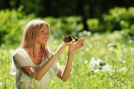 woman playing with butterfly photo