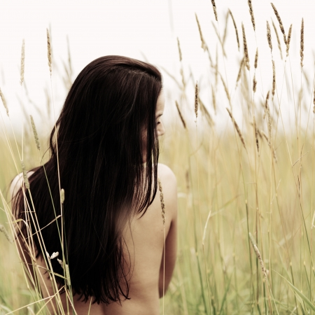 brunette naked: woman on grass field feel freedom