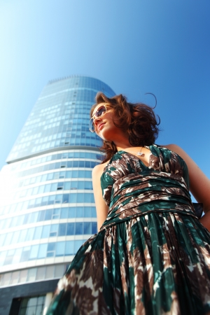glamorous girl in the background of a skyscraper photo