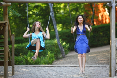young women swinging Stock Photo - 14995198