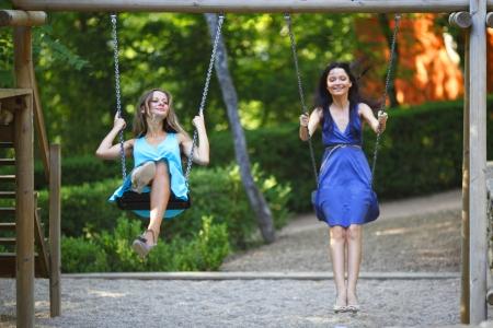 young women swinging Stock Photo - 14995198