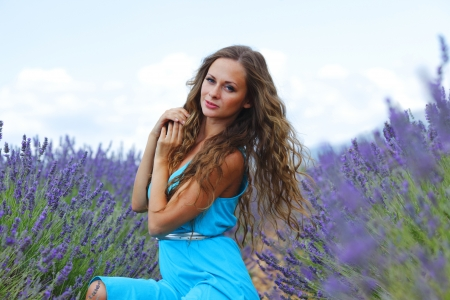 Woman sitting on a lavender field Stock Photo - 14995199