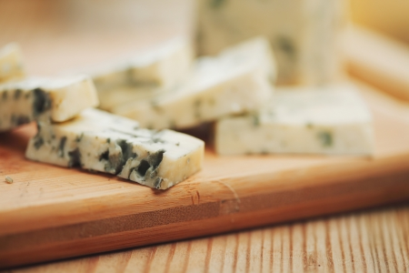 french culture: Blue cheese on wood plate Stock Photo