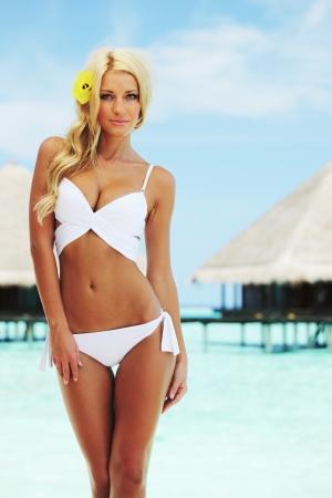 woman beach: woman on tropical beach house back on the background