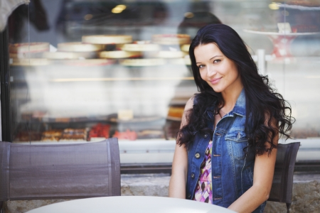 woman bar: beautiful young woman sitting alone in street cafe