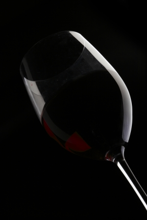 Red Wine Glass silhouette Black Background photo