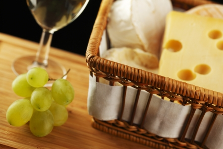 White wine in fine glass with cheese and grape photo