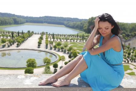 royal park: woman in Versailles gardens France