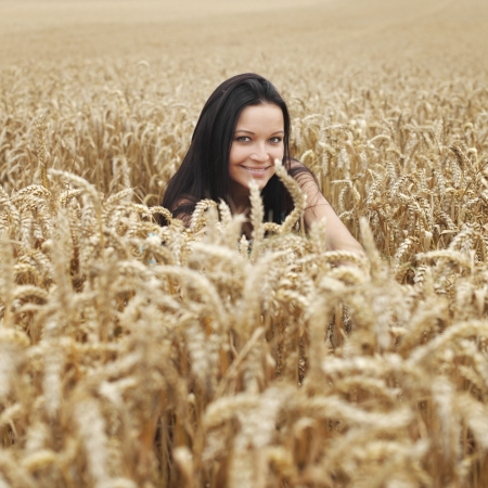 country lifestyle: woman on wheat field