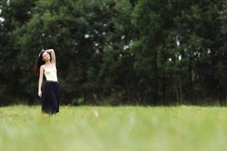 woman on green grass field photo