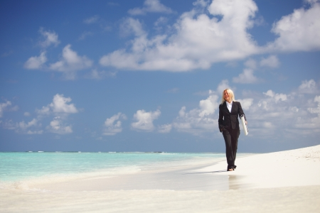 happy  business woman on the desolate ocean coast photo