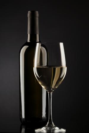degustation: white wine glass silhouette black background